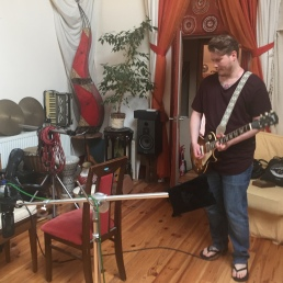 Jonny works on his guitar solo at Wavelength Studios